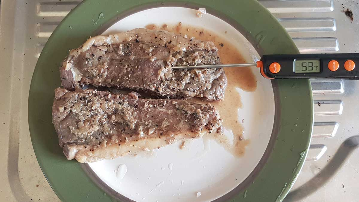 Steak reading an internal temperature of 53ºC after cooking in compost